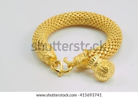 bracelet gold with money bag - stock photo