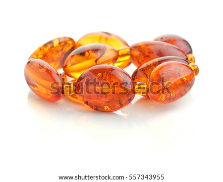 bracelet of pieces of brown amber on reflecting surface
