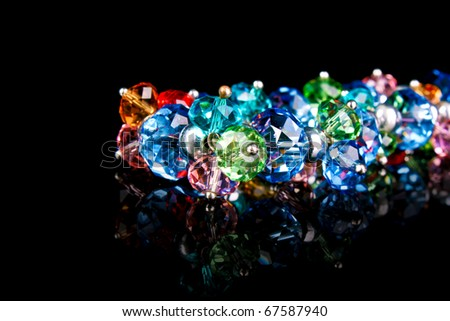 Bracelet on black background - stock photo