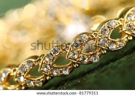 bracelet on textured background - stock photo