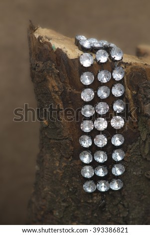 Bracelet on the log - stock photo