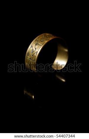 Bracelet with ancient Scandinavian designs - stock photo