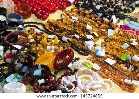 Bracelets and necklaces made of natural gems - stock photo