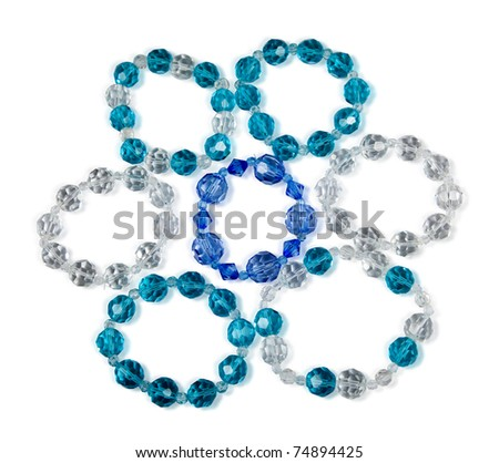 Bracelets made of glass on a white background isolated on white with clipping path - stock photo