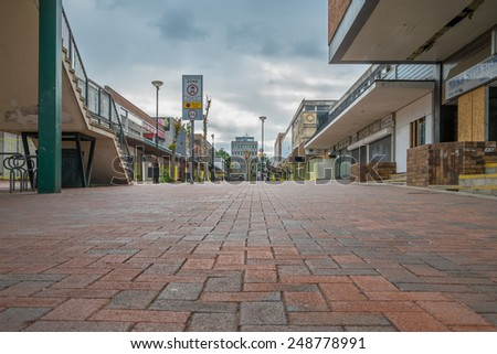 BRACKNELL, UK - AUGUST 11, 2013: An empty high street in the Berkshire town of Bracknell. Awaiting demolition to make way for re-development. - stock photo