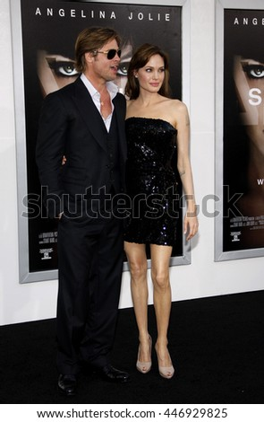 Brad Pitt and Angelina Jolie at the Los Angeles premiere of 'Salt' held at the Grauman's Chinese Theater in Los Angeles, USA on July 19, 2010. - stock photo