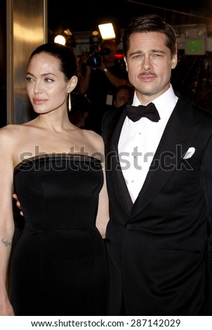 Brad Pitt and Angelina Jolie at the Los Angeles premiere of 'The Curious Case Of Benjamin Button' held at the Mann's Village Theater  in Westwood on December 8, 2008. - stock photo