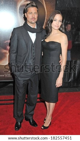Brad Pitt, Angelina Jolie, in a Versace dress and Sergio Rossi shoes, at THE CHANGELING Premiere at the New York Film Festival, The Ziegfeld Theatre, New York, October 04, 2008 - stock photo