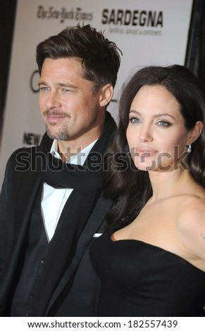 Brad Pitt, Angelina Jolie, in Mikimoto earrings, at THE CHANGELING Premiere at the New York Film Festival, The Ziegfeld Theatre, New York, October 04, 2008 - stock photo