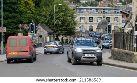 BRADFORD ON AVON - AUG 17: View of a busy road in the old town on Aug 17, 2014 in Bradford on Avon, UK. The historic Wiltshire town was a centre for the wool industry during the industralisation era. - stock photo