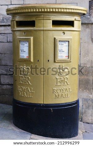 BRADFORD ON AVON - AUG 6: View of a gold postbox in honour of Olympic champion Ed McKeever on Aug 6, 2014 in Bradford on Avon, UK. Ed Mckeever won the 200m kayak race at the London 2012 Olympic Games. - stock photo
