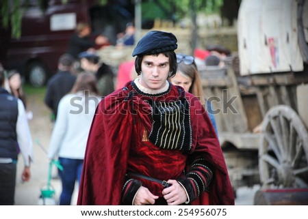 BRADFORD ON AVON - JULY 1: An unidentified actor walks through a during filming of Wolf Hall on July 1, 2014 in Bradford on Avon, UK. Wolf Hall is a period drama set in the 16th century. - stock photo