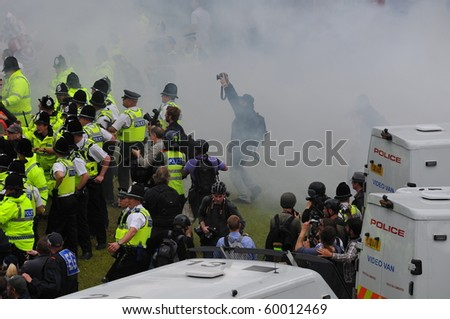 BRADFORD, WEST YORKSHIRE – AUG 28 : Police clash with EDL (English Defence League) supporters and Islamic protesters during a supposed peaceful demonstrations August 28, 2010 in Bradford, England - stock photo