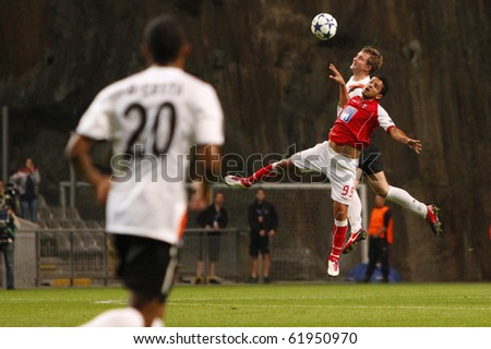 BRAGA, PORTUGAL - SEPTEMBER 28: Matheus (L), Braga's (POR) forwarder, loses ball possession to a Shakhtar Donetsk's (UKR) midfielder in Champions League match on September 28, 2010 in Braga, Portugal - stock photo