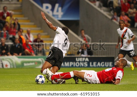 BRAGA, PORTUGAL - SEPTEMBER 28: Rodrigues (R), Braga's (POR) defender, tackles Shakhtar Donetsk's (UKR) forwarder Luis Adriano in UEFA Champions League match on September 28, 2010 in Braga, Portugal - stock photo