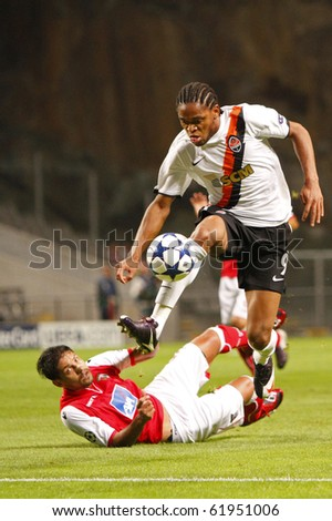 BRAGA, PORTUGAL - SEPTEMBER 28: Shakhtar Donetsk (UKR) forwarder Luis Adriano(R), leaves Braga's(POR) defenders helpless at the UEFA Champions League match on September 28, 2010 in Braga, Portugal - stock photo