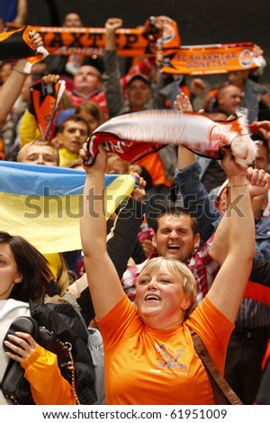 BRAGA, PORTUGAL - SEPTEMBER 28: Shakhtar Donetsk (UKR) supporters celebrate after winning the game against Braga (POR) in UEFA Champions League match on September 28, 2010 in Braga, Portugal - stock photo