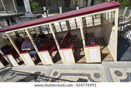 BRAGA, PORTUGAL - September 21, 2015: View of the funicular tram interior set up and the Portuguese style cobblestone access platform, on September 21, 2015 in Braga, Portugal. - stock photo