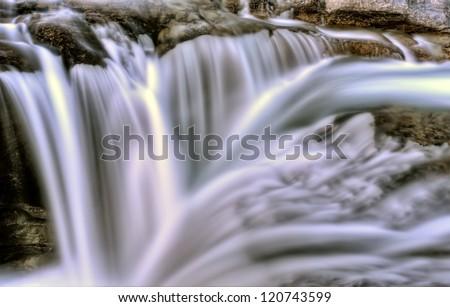Bragg Creek Waterfall sunrise Alberta Canada mountains - stock photo