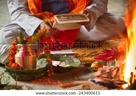 Brahman reading hindu mantra in Bardia, Nepal - stock photo