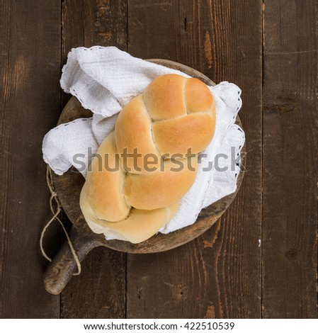Braided Bread on wooden cutting board