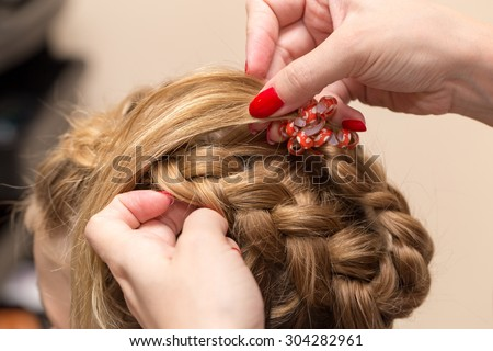 braided pigtails in the beauty salon - stock photo
