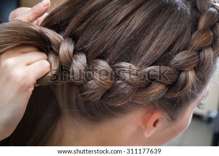 braided plait brunette at the beauty salon - stock photo