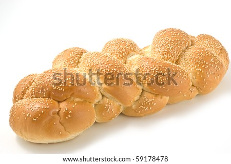 Braided sesame white loaf on white background