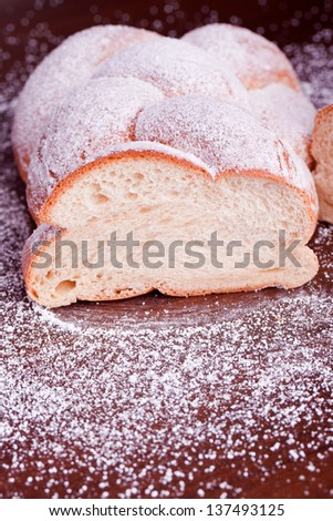 braided sugared yeast bread - stock photo