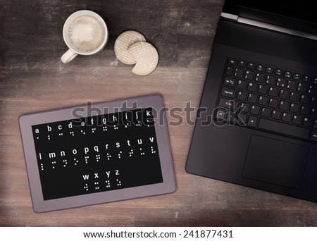 Braille on a tablet, concept of impossibility, vintage look - stock photo