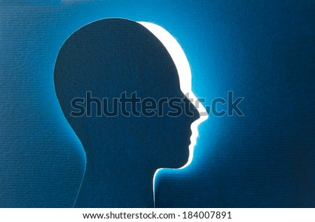 Brain aging and memory loss. The shape of a human head cut and detached from cardboard - stock photo