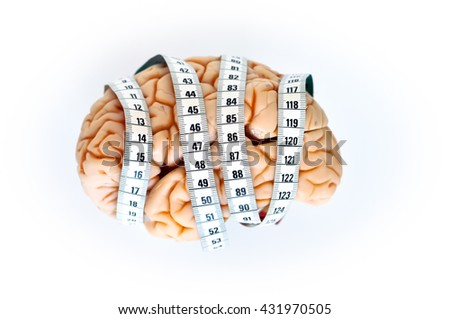 brain and tape measure, isolated on white background - stock photo