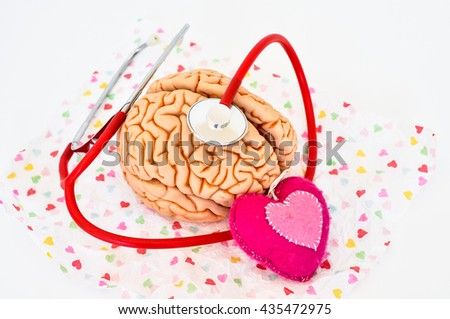 brain on wrapping paper with heart and stethoscope