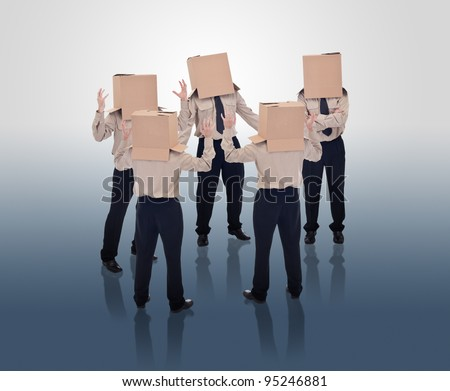 Brain storming businessmen with cardboard box heads - stock photo
