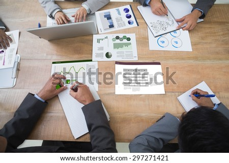 Brainstorm graphic against business interface with graphs and data - stock photo