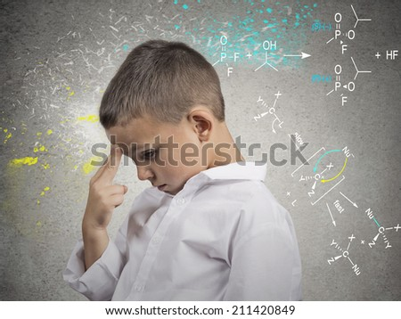 Brainstorm. Thoughts. Closeup side view portrait young man solving science problem, thinking hard, isolated on grey wall background. Human face expressions, emotions, body language, life perception - stock photo