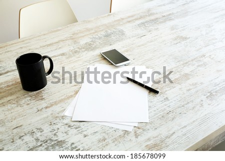 Brainstorming and taking notes at the table. - stock photo