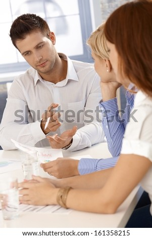 Brainstorming at businessmeeting, businessman concentrating on task. - stock photo