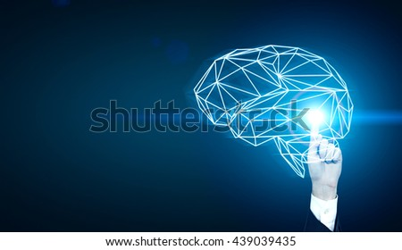 Brainstorming concept with businessman hand pointing at abstract illuminated polygonal brain on dark blue background - stock photo