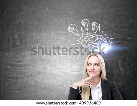 Brainstorming concept with happy businesswoman and lightbulb and brain sketch on concrete wall. Mock up - stock photo