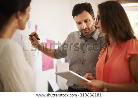 Brainstorming in corporation with the team  - stock photo