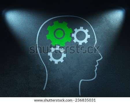 Brainstorming metaphor drawn on the wall in the light of  spotlights  - stock photo