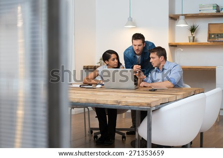 Brainstorming of multiethnic business people at office