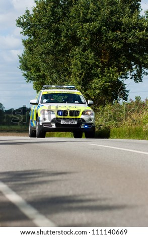 BRAINTREE UK - SEPTEMBER 10: Tour of Britain Cycle Race - Police BMW outrider during Essex Stage, Braintree, Essex, September 10, 2008 - stock photo