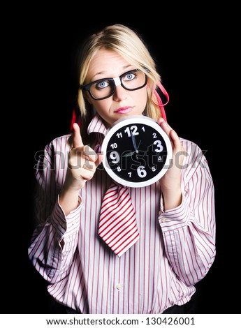 Brainy time management supervisor pointing to copyspace with dark clock in hand when gesturing time up