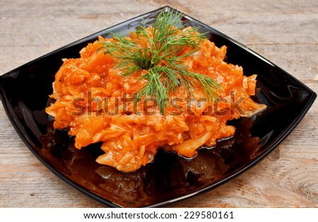 Braised cabbage in a bowl on a wooden table - stock photo