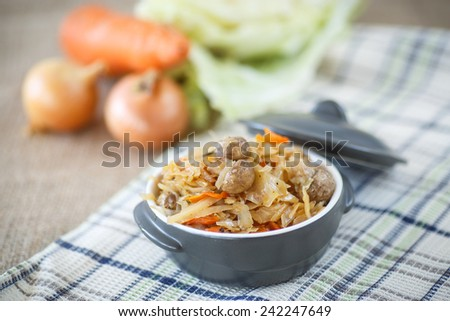Braised cabbage with carrots and mushrooms in a bowl