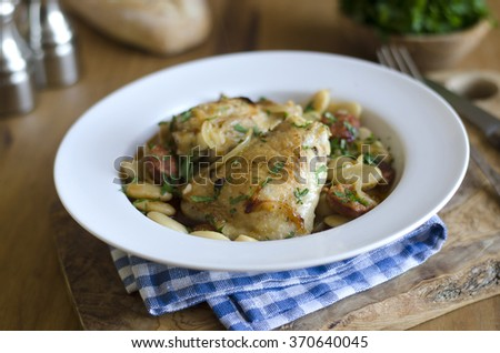 Braised chicken with chorizo and butter beans - stock photo