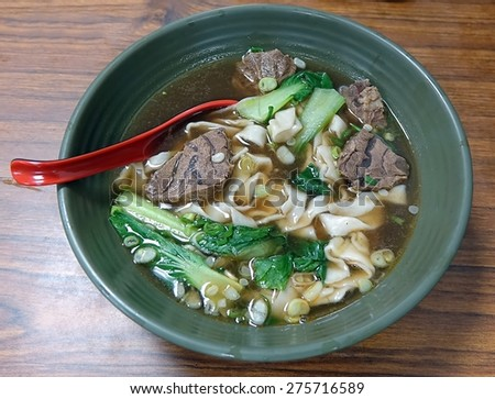 Braised chunks of beef in broth with noodles and chives is a popular dish in Taiwan - stock photo