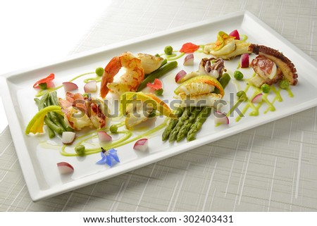 Braised Fish Dish Shrimp Lobster Scallop Squid Octopus Asparagus Pea Beans in square plate